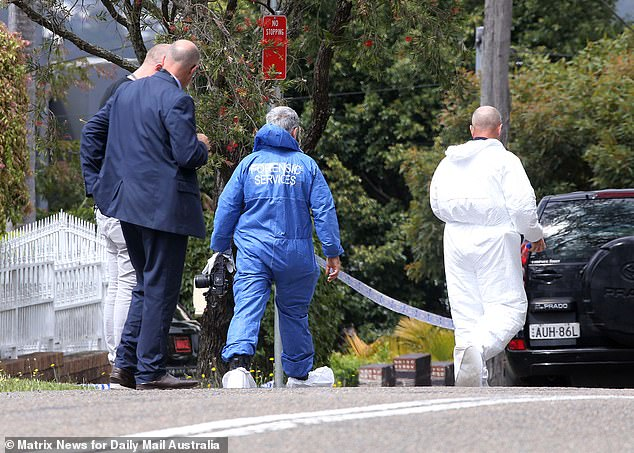 NSW Police Homicide Squad detectives are now leading the investigation are are hunting two gunmen over the killing (Pictured are detectives and forensic police at the scene on Monday)
