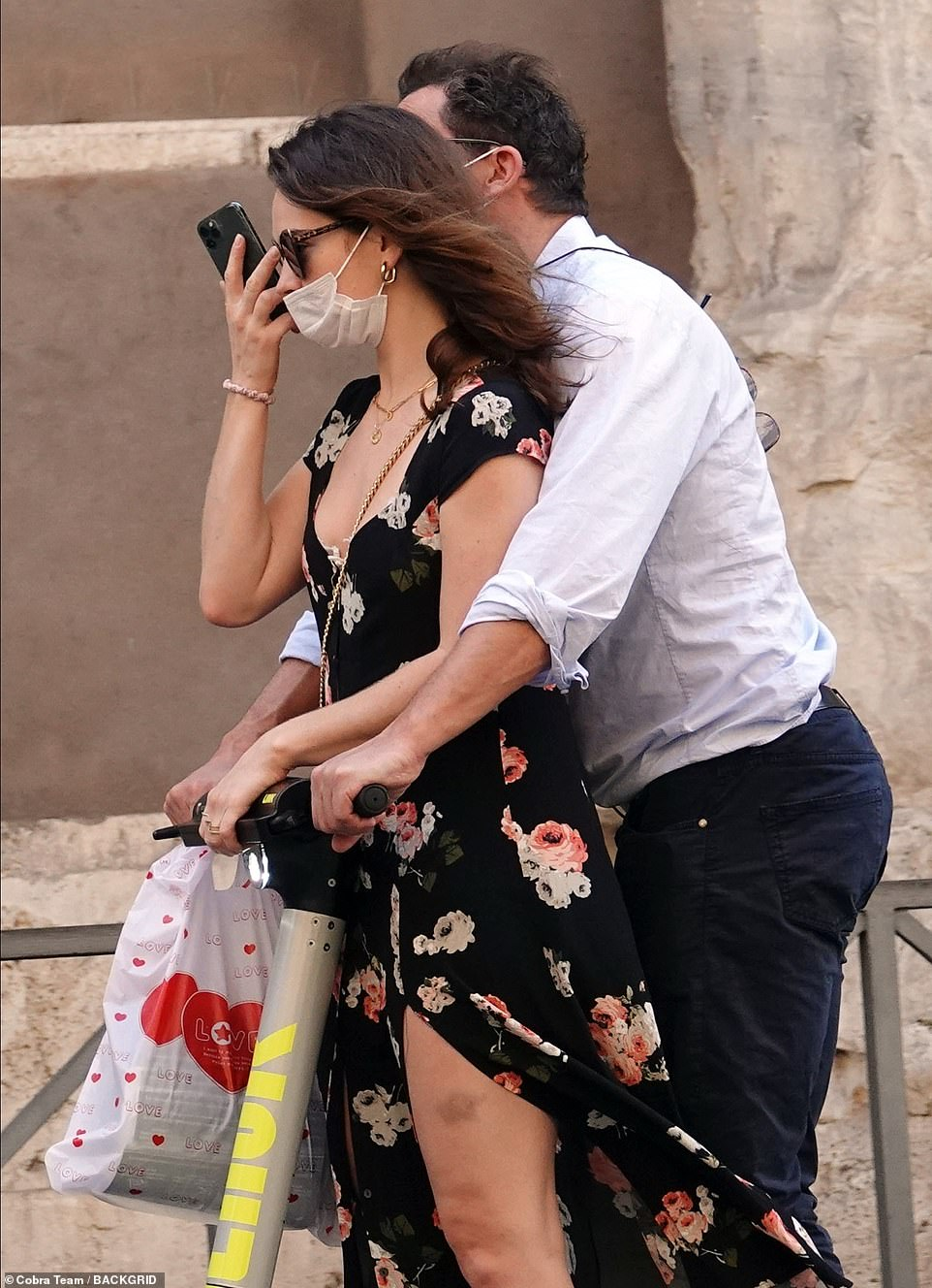 PICTURE EXCLUSIVE: Lily James, 31, and married The Affair star Dominic West, 50, were pictured passionately kissing and cuddling as they shared scooter ride during a romantic weekend in Rome on Sunday