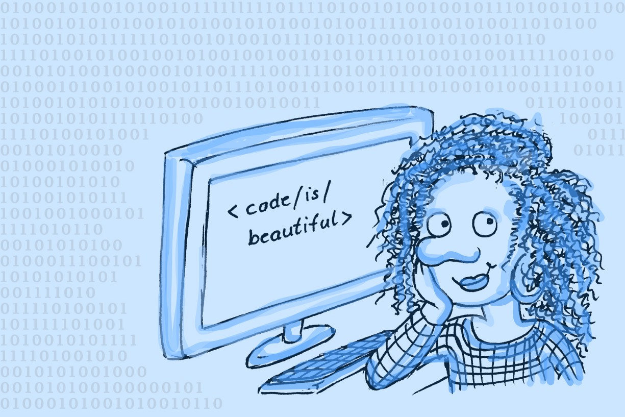 """Woman sitting in front of computer screen which shows the words """"code is beautiful"""""""
